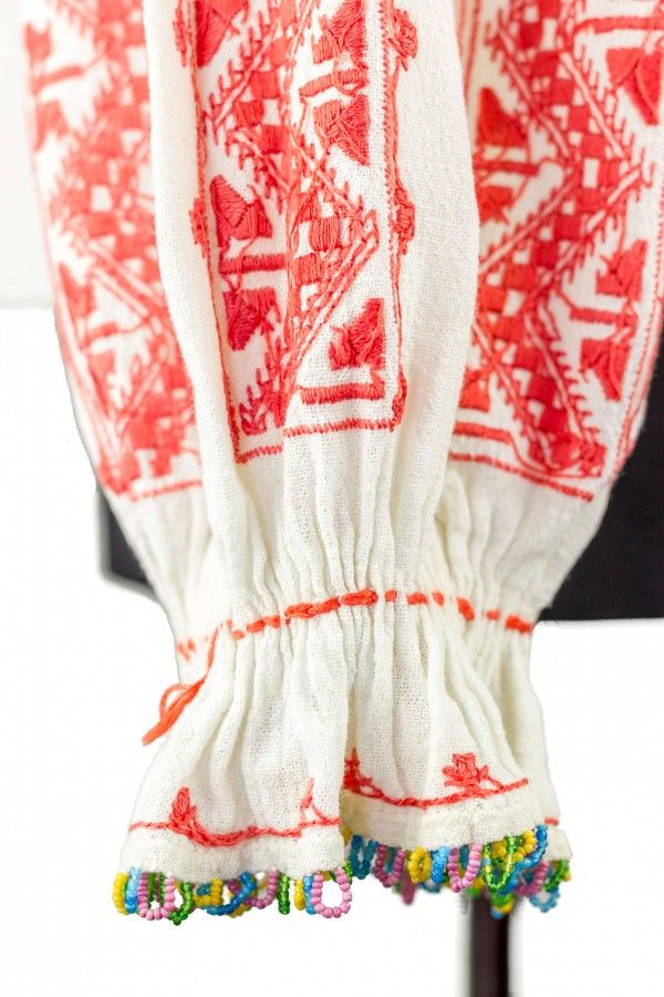 A very old Romanian traditional blouse with pleated gathered scoop neck and ruffled cuffs. Contrast embroidery. Embroidered neckband.