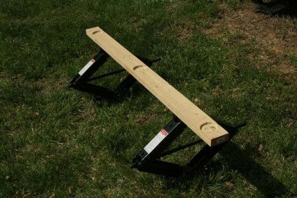 Scissor jacks and a 2x6 to create a support for the toy hauler ramp door.