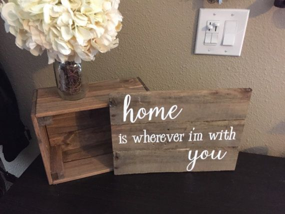 Home is Wherever Im with You Sign is an elegantly painted sign that says everything you want to say to your loved ones. Great for hanging on the wall or placing on a mantel or shelf. This sign is pictured above in natural wood with White paint. The dimensions of the sign is roughly 11 inches high and 14 inches wide. The sign is made on reclaimed pallet wood. Each piece of pallet wood has its own unique characteristics. Therefore it could have additional knots or nail holes, or it might be a…