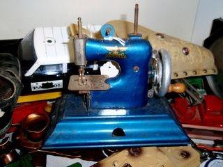 Child's blue vintage sewing machine