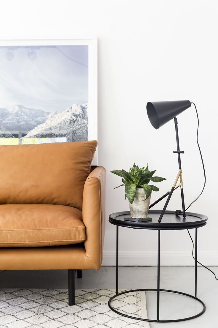 The clean black lines of the Freda side table hold up the cheeky and sculptural Pinocchio table lamp. Tan leather sofa 'Louis' looking handsome and masculine.