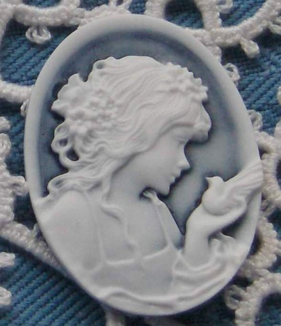 Cameos Depicting A Little Girl Holding A Dove