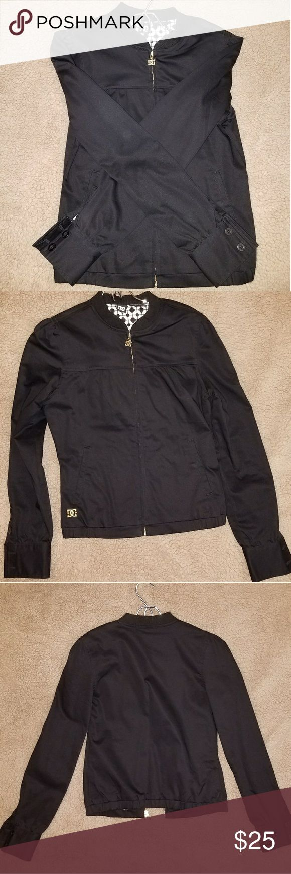 DC Shoe Co Women's Light Weight Jacket Size S Women's DC Shoe Co Black Light Weight Jacket Size Small. Black twill type of fabric, Zip up, front pockets, pleated yoke, pleated shoulders, button cuffs, DC zipper pull, DC embroidered in gold on front right hip, DC printed light weight lining. Super cute dressed up or down. Please ask questions. Comes from a pet friendly home. DC Jackets & Coats