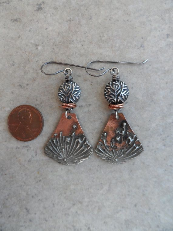 Amazing copper with silver solder charms, expertly handcrafted by an etsy artisan, are perfectly paired with solid sterling silver (925) beads, as well as cute little double ring spacers. Wire-wrapped together with solid oxidized sterling wire and suspended from sterling earwires, these one-of-a-kind (OOAK) earrings measure about 2 1/2 from end to end. LOVE