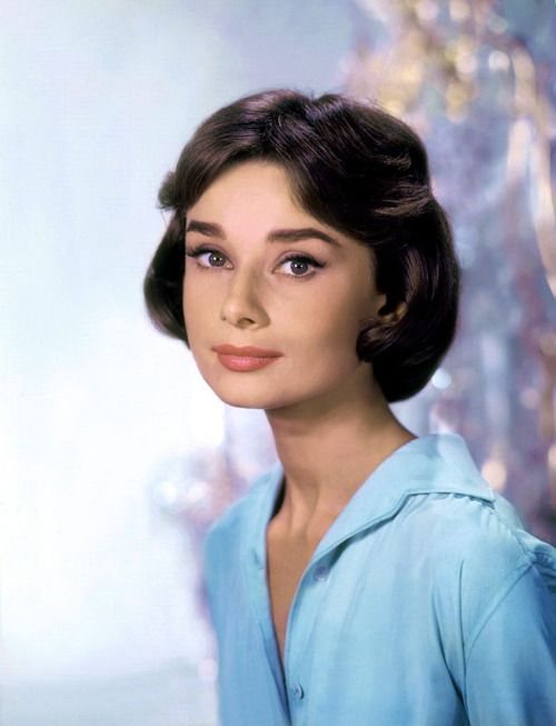 """thefashionofaudrey:  The actress Audrey Hepburn photographed by Willy Rizzo at the Studios de Boulogne, on Avenue Jean-Baptiste-Clément, in Boulogne-Billancourt, a commune in the western suburbs of Paris (France), during break in the filming of """"Love in the Afternoon"""", in September 1956.Note: Her hairstyle called """"Paris heart"""" was created by the famous American hairdresser Kenneth Battelle."""