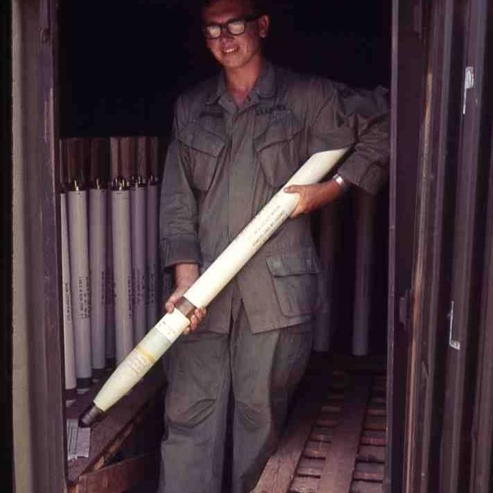 US airman holding a 2.75″ folding fin aerial rocket armed with a white phosphorus warhead, circa 1969.