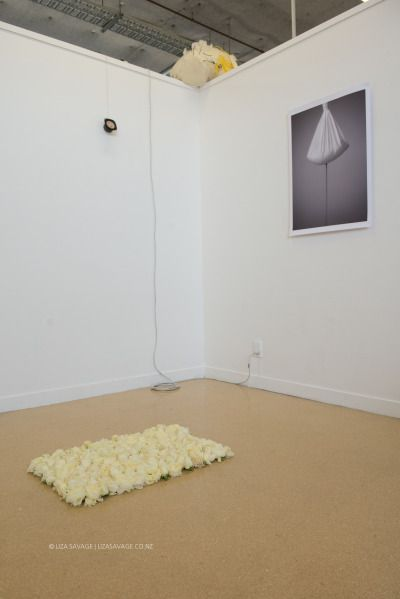 """The final installation of my three works. I want to say a HUGE thank you to The Flower Delivery Company for donating the beautiful rose heads. The work which is made up of the flowers on the floor is titled: Rest (2015).   Also, """"I Sound For You"""" 2015, and """"Hanging Sand"""" 2015."""