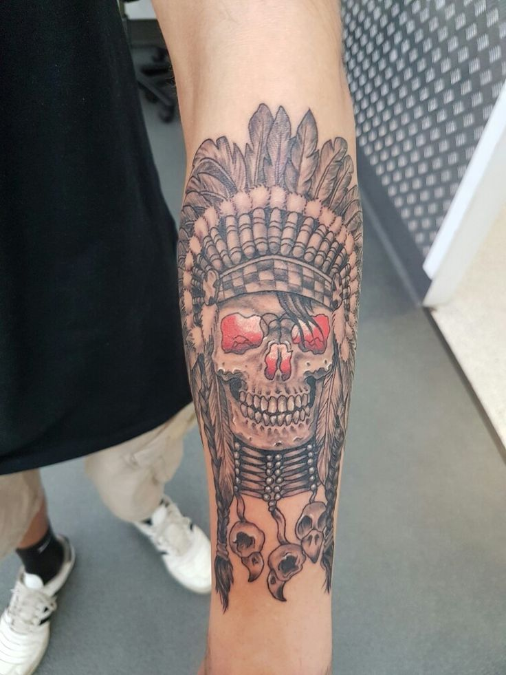Skull with indian head dress.