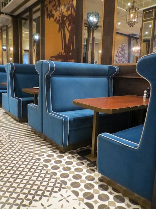 Chez Coco opened it's doors this Summerin Barcelona and focuses entirely on rotisserie chicken. Spanish designer Lazaro Rosa Violan has included beautiful high bright blue couches intrictae tiled flooring. And not a distressed brick wall in sight.