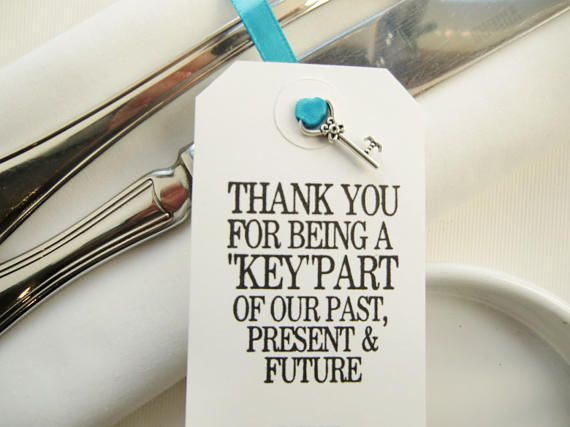 3.75 x 1.75 Elegant White Tags Tags threaded with Ribbon or String with Silver Colored Mini Key Favor - to tie around Rehearsal Napkins/Rehearsal Silverware Rehearsal Dinner Decorations/Rehearsal Dinner Ideas/Rehearsal Dinner Favors Handprinted - THANK YOU BEING A KEY PART OF OUR PAST, PRESENT AND FUTURE/YOUR NAMES AND DATE These simple elegant white tags with mini key favor and personalized with Names/Date convey a lovely message to your guests - thanking each of th...