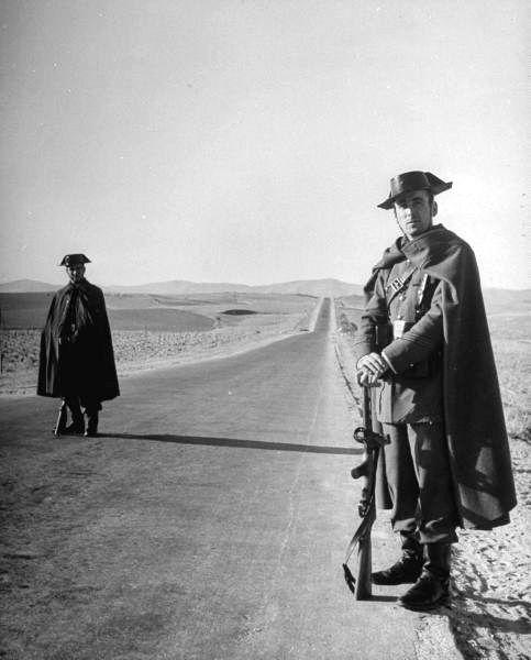 Guardia Civil soldiers patrolling roads on foot. Photograph by Dmitri Kessel. Spain, 1949.
