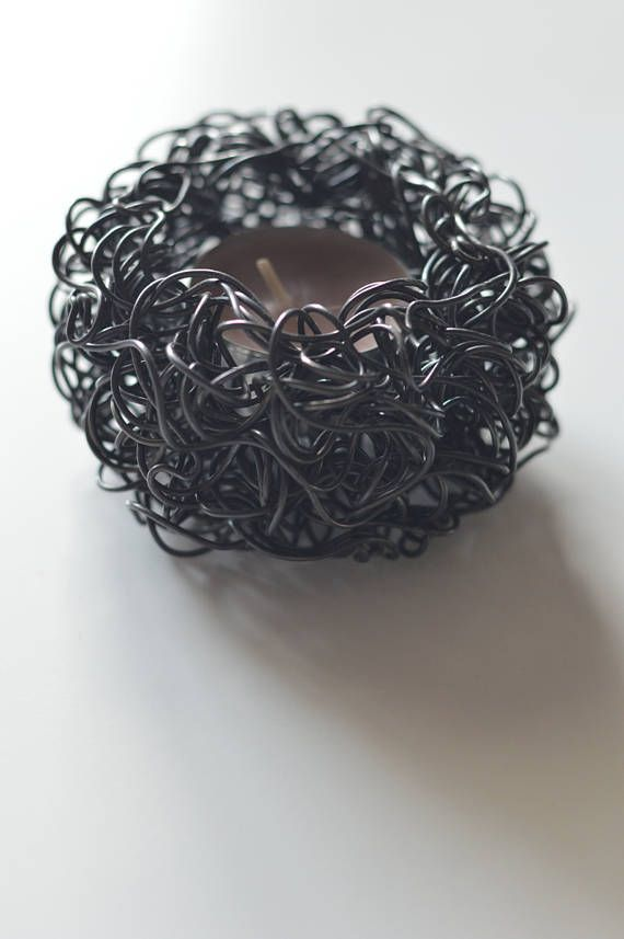 Contemporary candle holder made of burnt steel wire.   Dimensions  Height (approximately): 5 cm (2.0 inch)  Diameter (approximately): 8 cm (3.1 inch)  Hole diameter: 4 cm (1.57 inch)  Tea light included!  Candle holders are made in Belgrade (Serbia).