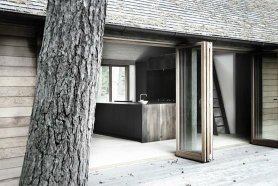 A Nordic cabin spotted in the portfolio of Københavns Møbelsnedkeri, a Copenhagen furniture design company with a special affinity for wood.-  Folding doors create an indoor outdoor feel.