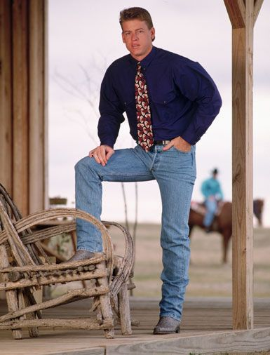 Troy Aikman, 1993     How can you be a real cowboy when your shirt is so blousy that it rivals Jerry Seinfeld's puffy shirt and your tie appears to be repurposed from Grandma's stockpile of quilting fabric?