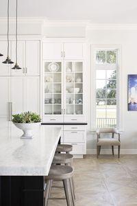 Clean and simple kitchen. Gorgeous floor! Wood floor, white kitchen, kitchen design