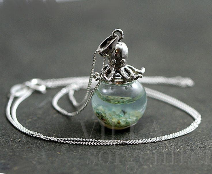 Sterling octopus seawater necklace. 925 sterling octopus carrying glass orb filled with seawater and sand. Sterling necklace. by VillaSorgenfrei on Etsy https://www.etsy.com/se-en/listing/243958250/sterling-octopus-seawater-necklace-925