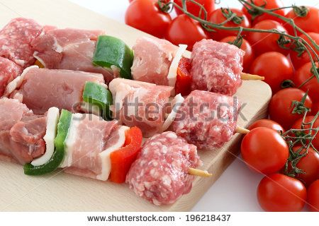 Raw meat skewers with cherry tomatoes by rossella, via Shutterstock