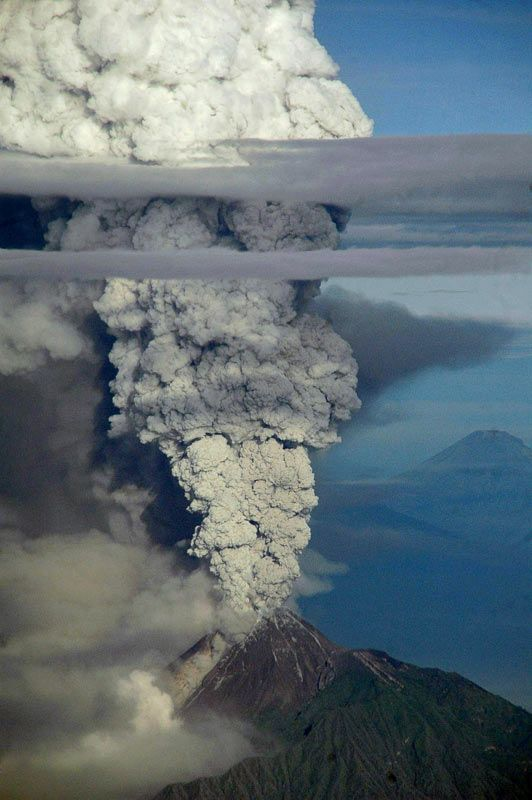 A view from a domestic flight from Denpasar to Yogyakarta that was subsequently diverted to Surabaya airport shows a plume of gas and ash billowing some 10 km (six miles) high from the Mount Merapi volcano during an eruption