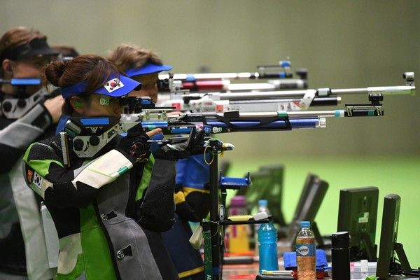 South Korea's Kim Eunhye competes in the women's 10m air rifle shooting qualifications at the Rio 2016 Olympic Games at the Olympic Shooting Centre in Rio de Janeiro on August 6, 2016. / AFP / Pascal GUYOT