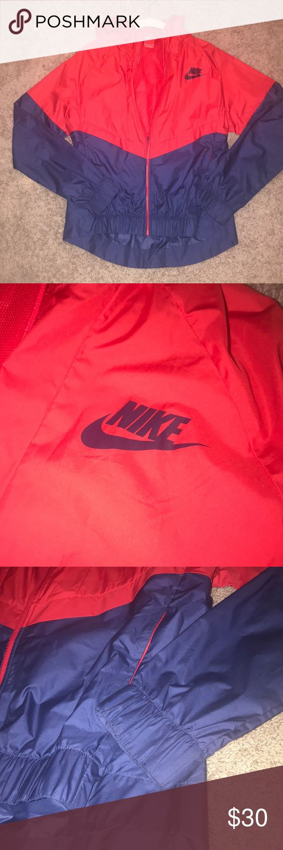 Nike Rain Jacket/Windbreaker Red and blue jacket! Could be worn in light rain or just as a workout jacket or windbreaker. I wore it once to go hiking in!  The back has a flap with mesh under it to be breathable! Has a hood Nike Jackets & Coats Utility Jackets