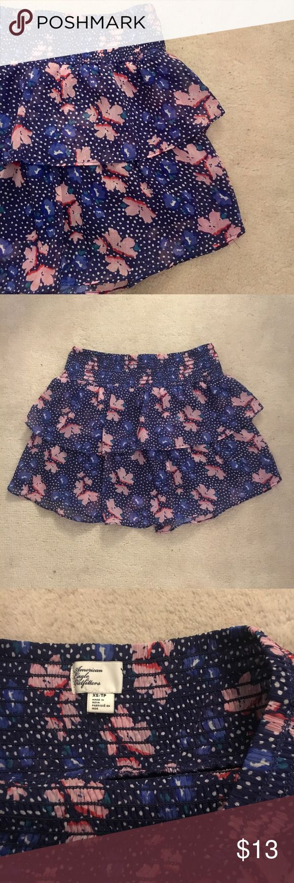 """American Eagle Floral Skirt Excellent condition American Eagle Outfitters navy and pink floral skirt! Worn maybe three times. Sheer layers on top with a solid navy layer underneath. Length is approximately 14"""", and waist is approximately 13"""".                     Suggested user + top rated seller + fast shipper! American Eagle Outfitters Skirts"""