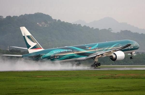 """The Boeing 777 is a long-range, wide-body, twin-engine jet airliner manufactured by Boeing Commercial Airplanes. It is the world's largest twinjet and is commonly referred to as the """"Triple Seven"""".[3][4] The aircraft has seating for over 300 passengers and has a range from 5,235 to 9,380 nautical miles (9,695 to 17,370 km), depending on model. http://flyboyzs.com/image/34-cathay-pacific#fwgallerytop, #FlyboyzsTheBoeing777 #Flyboyzs"""