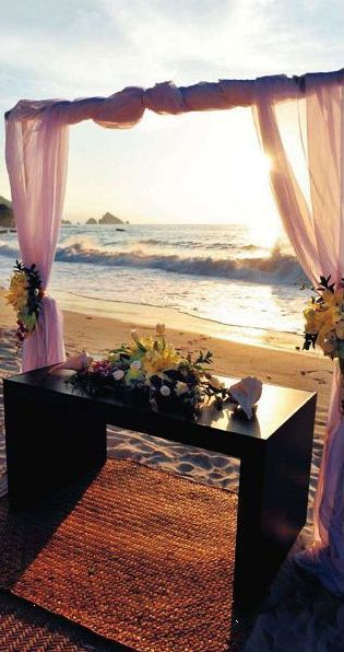 If I were to have a beach ceremony for my wedding I would love the pink curtains or whatever colour and have the table on the side out of the way! Other than that it is gorgeous