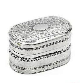 A rare George III sterling silver (NOT silver plated) nutmeg grater, by Joseph Willmore, Birmingham, England, 1814.  Of rectangular form with rounded ends, the lid decorated with seaweed motifs, plain central reserve, the sides with bright engraved bands, hinged steel rasp.    Length 3.5cm / 1.38in.    Height: 2.2cm / 0.86in.    Weight: 16gr / 0.51oz.    Fully hallmarked for Birmingham, England, dated 1814, maker's mark for Joseph Willmore