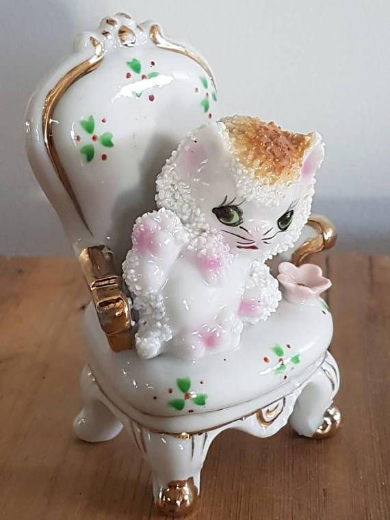 Check out this item in my Etsy shop https://www.etsy.com/au/listing/557462365/vintage-kitty-cat-on-a-chair-figurine