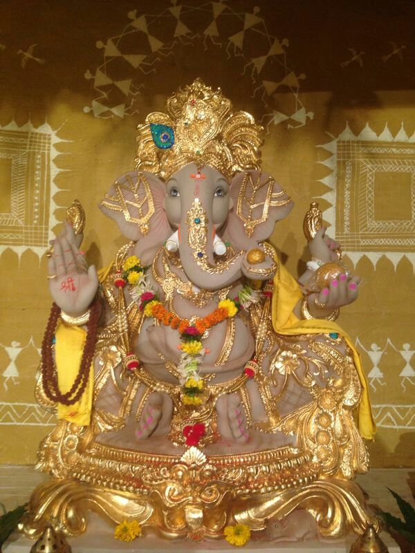 Lord GANESH  with Worli paintings in the background