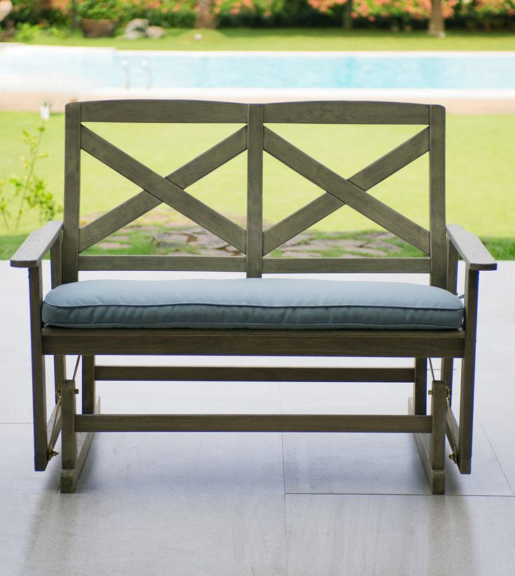 """Cambridge-Casual 130825BLU West Lake 4' Glider Bench with Seat Pad, Weathered Grey With Spruce Blue. Made of solid Plantation mahogany wood. Smooth motion. Hand rubbed weathered look finish, with Polyurethane coating for long lasting outdoor use. Mortise and Tenon construction. 2"""" thick spun-polyester seat pad."""