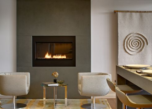 concrete fireplace surround with a spark fireplace