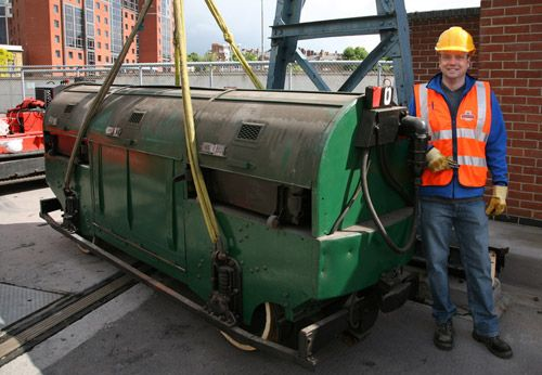 Senior Curator Chris Taft poses with Mail Rail rolling stock recovered from the underground tunnels at Mount Pleasant Sorting Office, London in 2011.