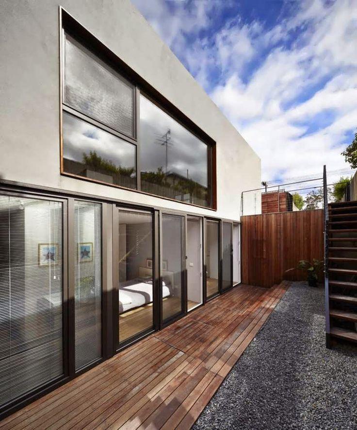 Little Gray Sunken House Minimalist Design with Small Room in Underground
