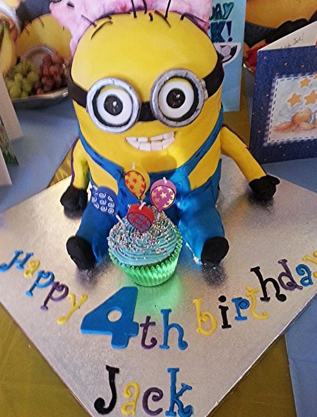Double Minion Cake: One side yellow minion, the other one purple minion.