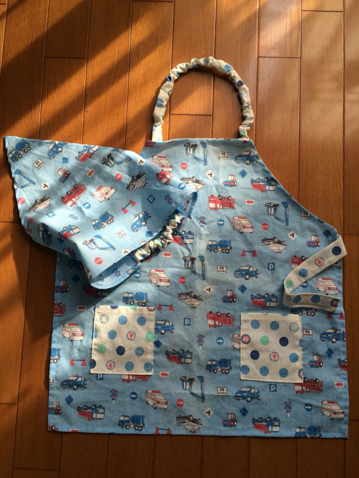 Kid's apron and kerchief.