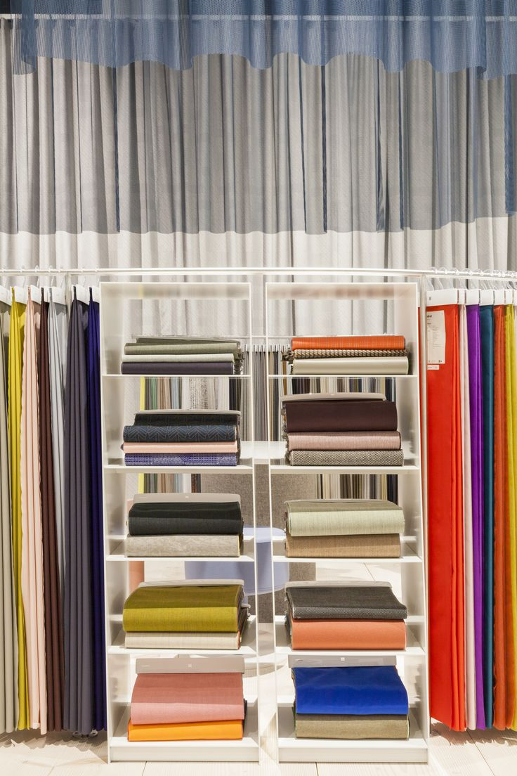 Textiles in all forms. A vibrant selection of patterened, velvet, woolen and translucent textiles shown at Orgatec. The draped, grey curtain by Doshi Levien beautifully envelopes the space. Photo: Patricia Parinejad