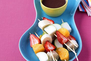 Children's party fare can be both yummy and relatively healthy. When served with a delicious chocolate sauce, these fruit kebabs are guaranteed to please the fussiest eaters. Kids will find them even more appealing if they're allowed to choose the fruits.