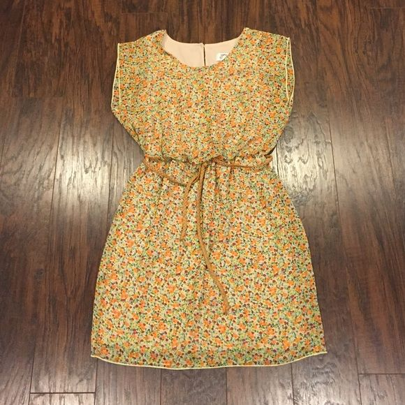 Yellow Floral Dress Beautiful dress, very good condition. Has a belt attached. Waist is elastic. Size is S but fits more of a XS. Dresses