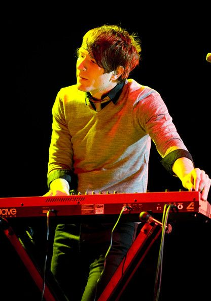 Adam Young Photos - Adam Young of Owl City performs onstage at the Q102 Jingle Ball at the Susquehanna Bank Center on December 9, 2009 in Camden, New Jersey. - Q102 Jingle Ball Concert