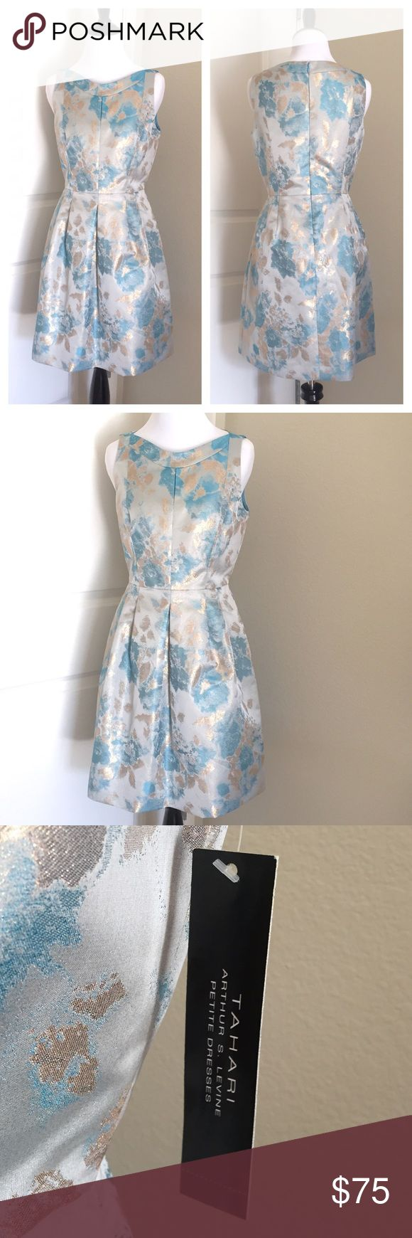 "NWT Tahari Sky Blue/ Gold  Petite Dress Brand new with tags. Such a pretty dress for spring! This floral jacquard dress by Tahari features a fit and flare silhouette; rounded neckline; side hand pockets; straight hemline; back zipper closure that extends three fourths of the way down the back for easy wearability; comes fully lined. Material: 83% Polyester, 17% metallic; lining: 100% polyester. Size: 4P. Dry clean only. Length: Approx. 34"". Price is Firm🌷 Tahari Dresses"