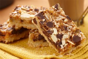 Magic Chocolate Toffee Bars- With toffee, chocolate chips, almonds and coconut, the taste of these bars can only be described as magic. Make them with your kids for the ultimate snack.