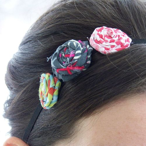 With a little elastic, some fabric scraps, and a hot glue gun you can easily make your own rolled flower headbands.