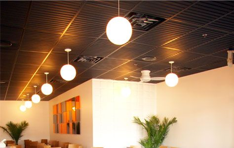 Ceilume offers wide variety of styles in the 2x2 tiles and 8 in the 2x4 panels. Color options include white, sand, latte, merlot, black and translucent.  The product is a cost effective option for residential installations as well. A friend of mine installed them in his basement using the black finish to update the boring stained existing panels. Completed, the atmosphere of the room was entirely elevated.  Lending themselves to a variety of installations, the various design options bring a…