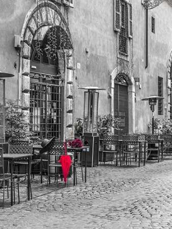 Red umbrella with female hat and bunch of roses on cafe table, Rome, Italy