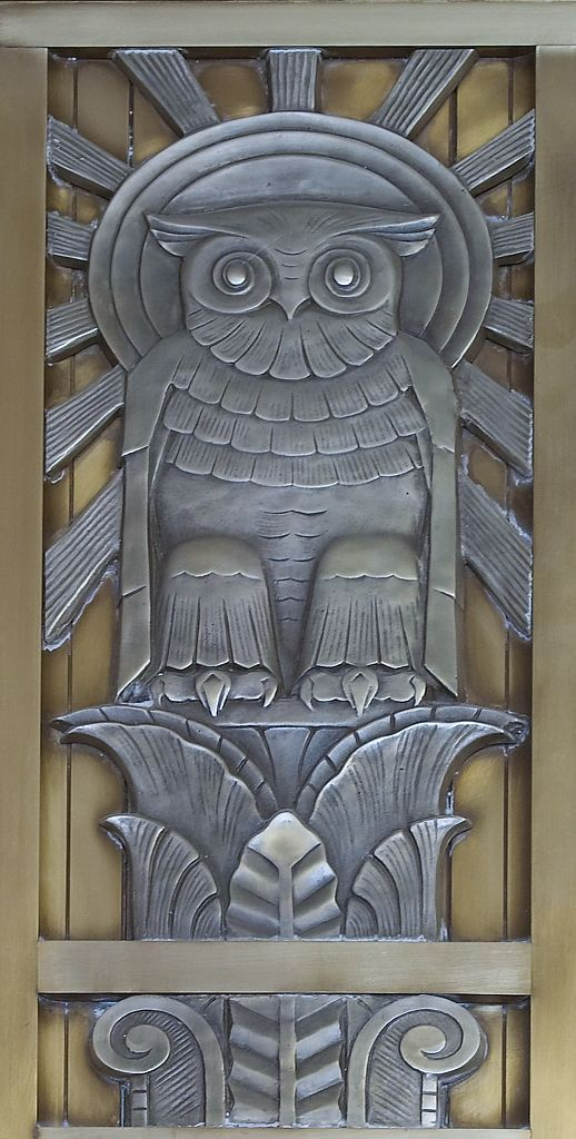 Art Deco Period with a stylized Owl, Sun, and Sun Rays
