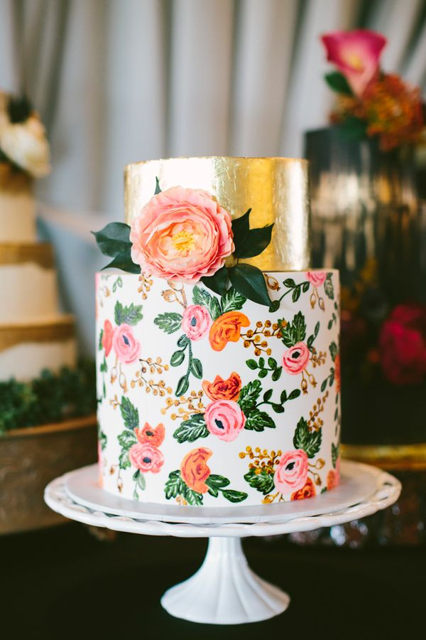 Floral cake with a gold-leafed top tier