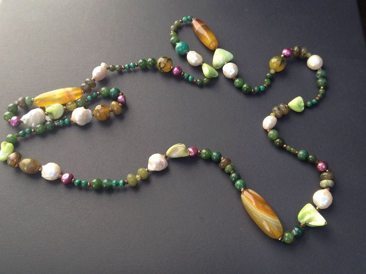 The necklace is handmade, with stones and pearls.