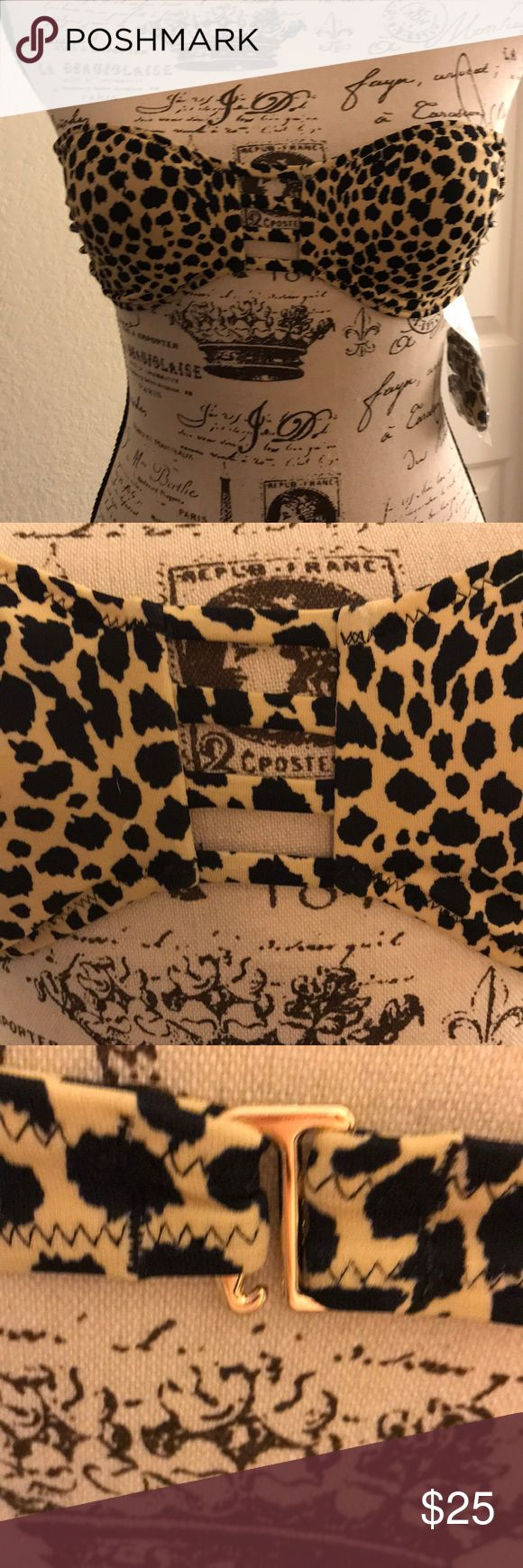 🌸VICTORIA SECRETS SWIM BIKINI TOP Beautiful leopard print bandeau style bikini top with adjustable straps if you choose. Signature gold clasp at back And three strap cut out in center front. Easily paired with so many bottoms, check out the black crochet I have. Victoria's Secret Swim Bikinis