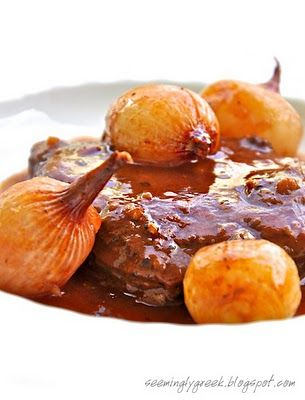 Greek Beef Stifado Recipe: Makes 2 servings 2-3 T. EVOO 2 good braising steaks of beef, whole or cubed 2 garlic cloves, minced 1/2 tsp. cumin 1 small cinnamon stick 3 fl. oz. red wine 1 T. red wine vinegar sprig of fresh rosemary, I didn't have at the time 1 bay leaf, torn 1 T. tomato paste or puree 1 1/2 – 2 cups hot water 8-10 pearl onions 1-2 tsp. raw sugar s/p (salt and pepper)